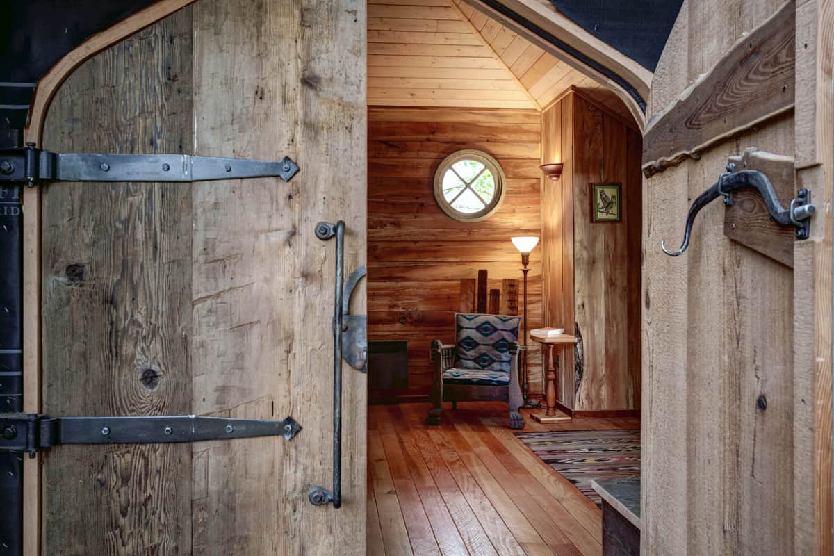 Wooden door entry to glamping treehouse in Washington