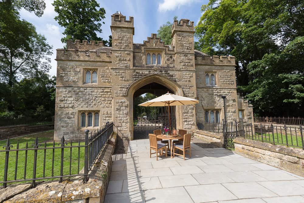 Castlegate glamping castle view from outside with table and trees