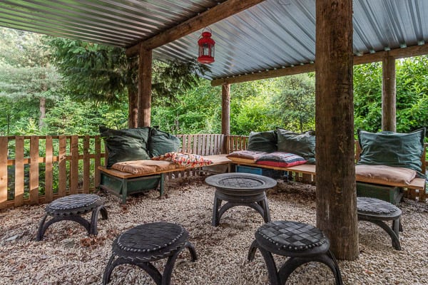 seating area with pillows and tables for glamping cotswolds