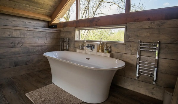 view of inside a glamping cabin with a tub
