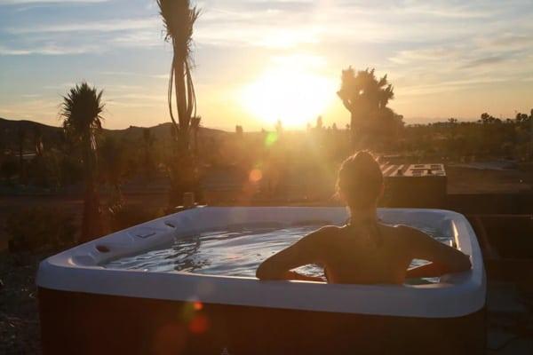 Joshua Tree Glamping Yurt at Joshua Tree Houses Hot tub view with sunset