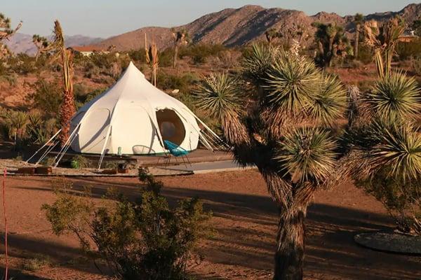 Joshua Tree Glamping Yurt at Joshua Tree Houses view of tent in desert