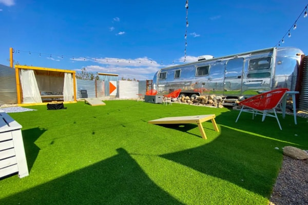 Airstream Oasis in Joshua Tree  view inside of trailer with bed and kitchen painted blue