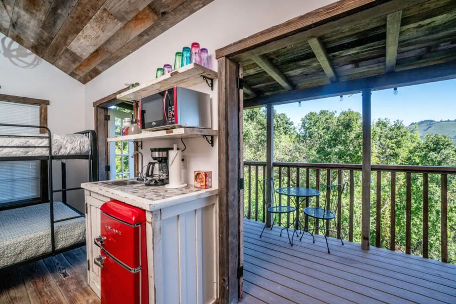 rustic glamping Tiny House view of inside and out onto the deck