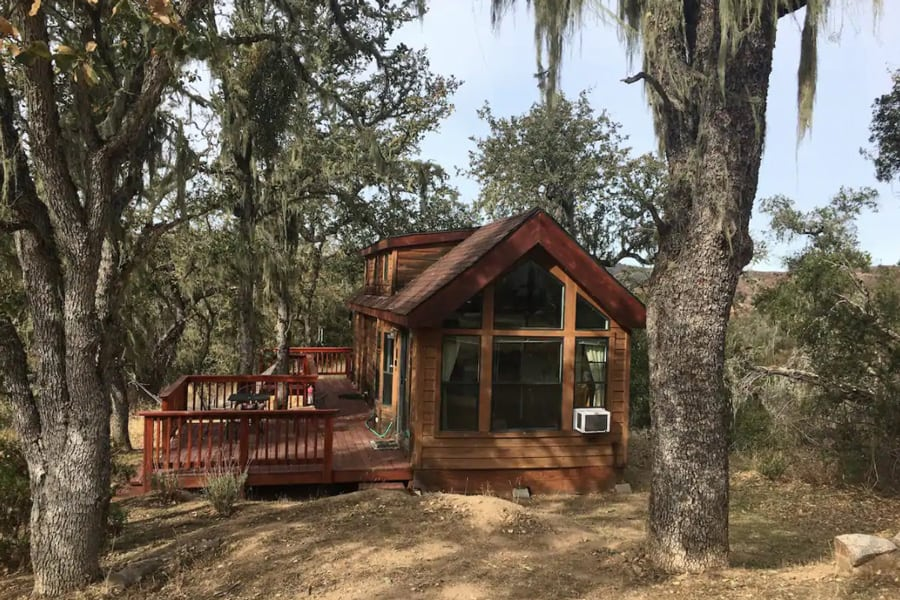 Tassajara Tiny House Glamping Big Sur view of home with front windows, deck and trees around