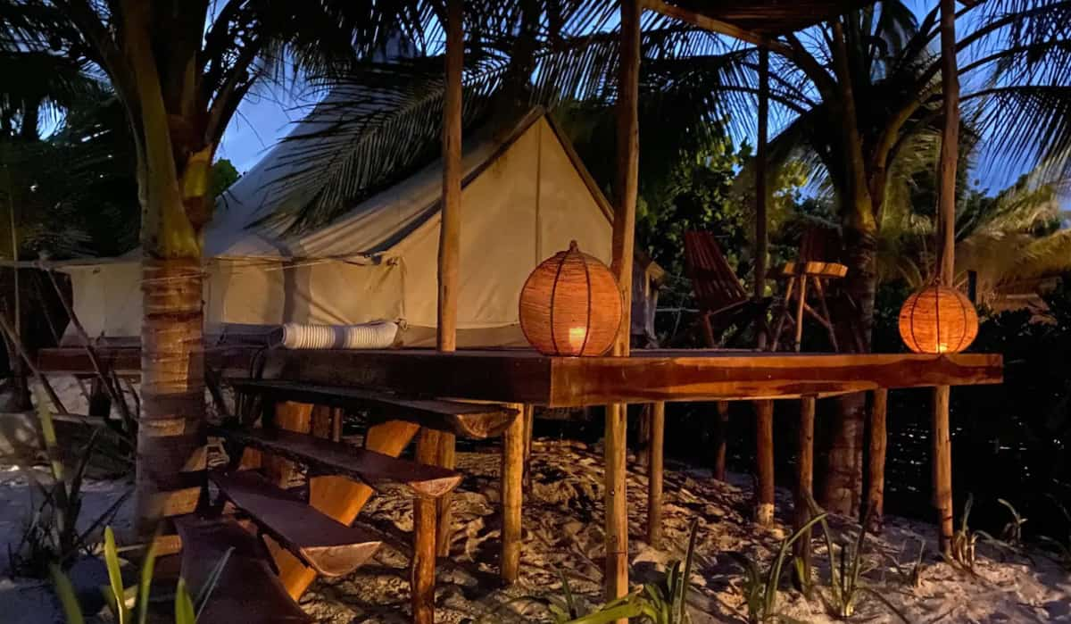 Glamping tent on a rasied deck at night