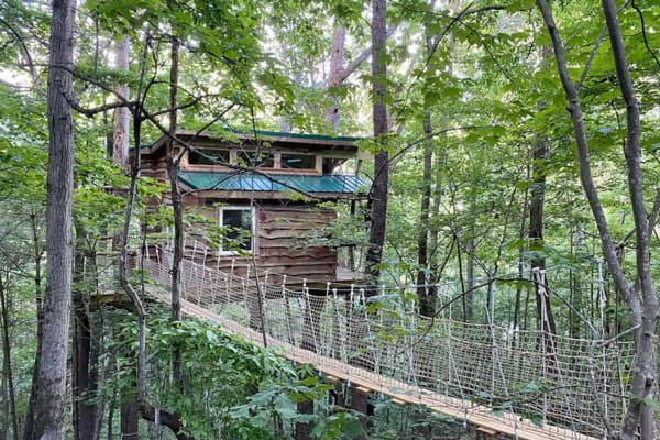 West Asheville Treehouse rental view from hanging bridge with treehouse in the trees