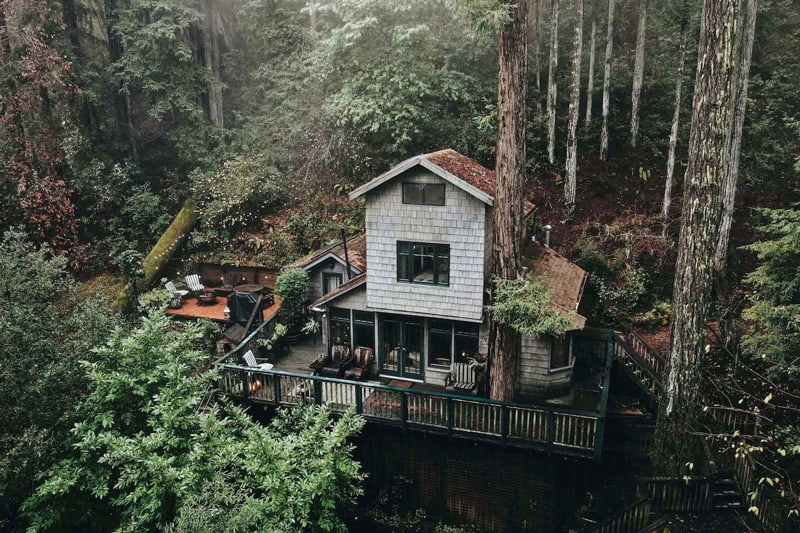 crows nest glamping treehouse bay area view from above with the 2 story treehouse with deck on hillside