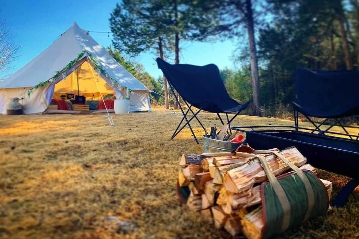 Best Glamping Arkansas Spots view of glamping bell tent with firepit and wood