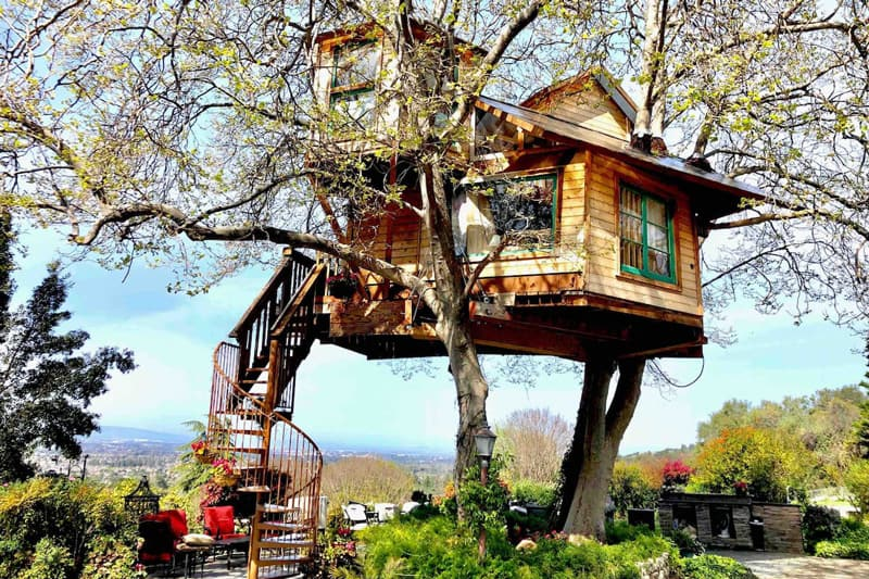 Glamping Treehouse Santa Jose California view of treehouse with spiral staircase and view of the valley