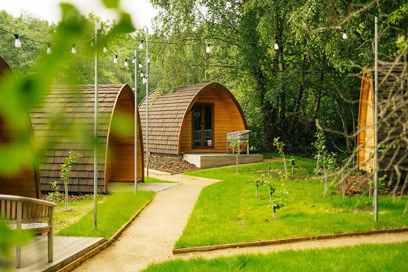 Adventure Parc Snowdonia Glamping  pods view of multiple wooden pods and the garden