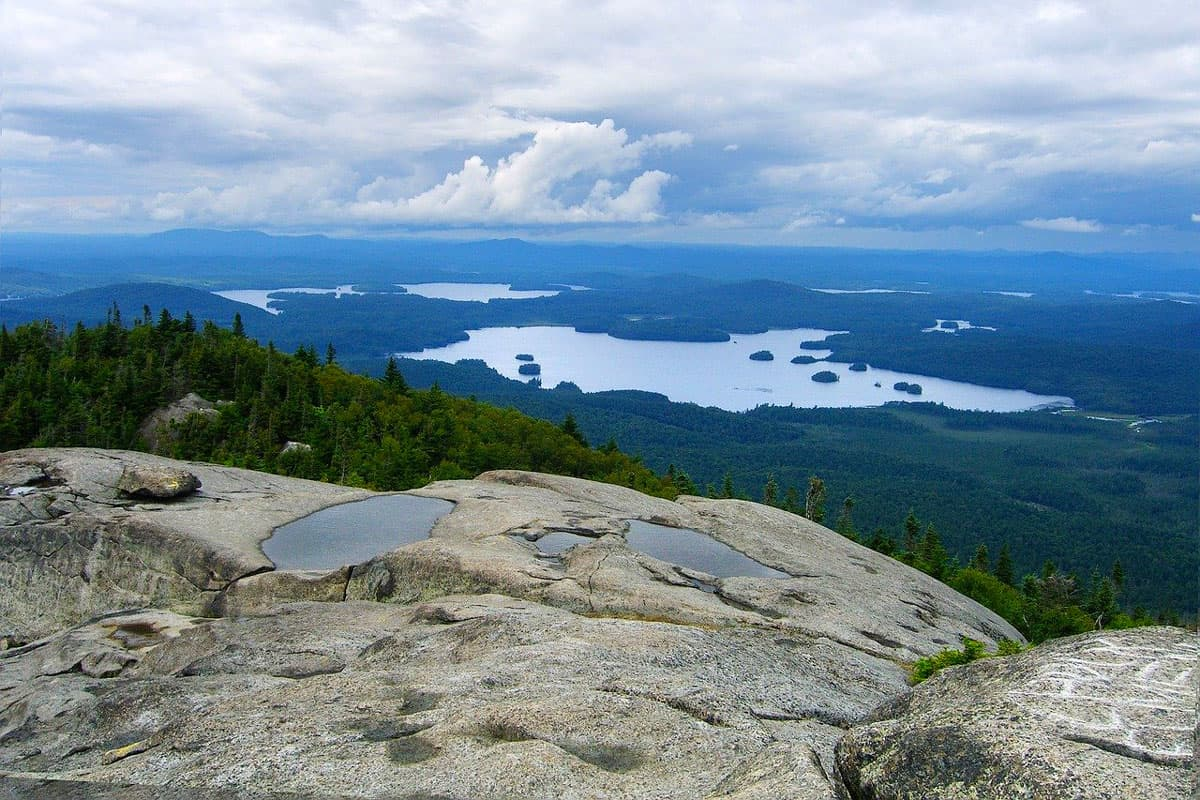 Awesome Glamping in the Adirondacks NY view from the ledge of a mountain with lakes below