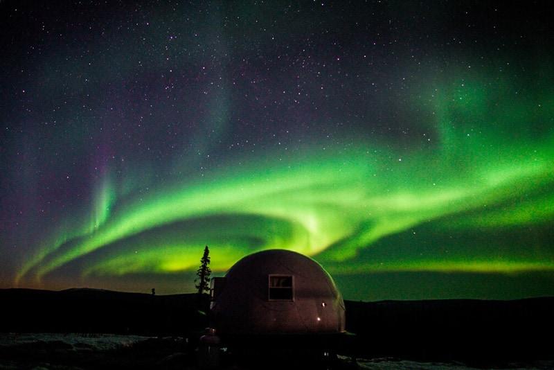 Borealis Basecamp Glamping Pod dome view at night with northern lights