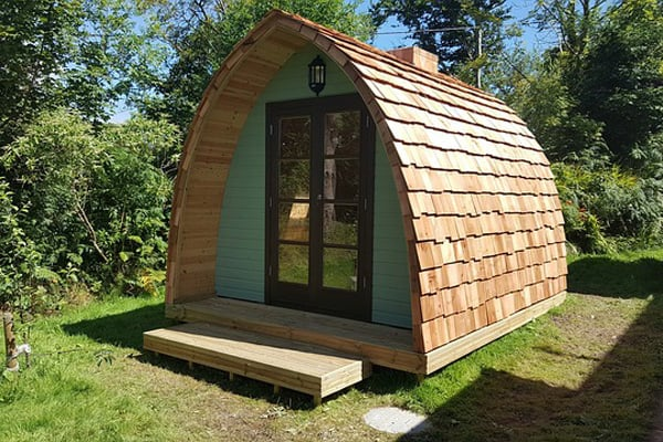 wooden pod glamping view of the pod with step deck and french doors