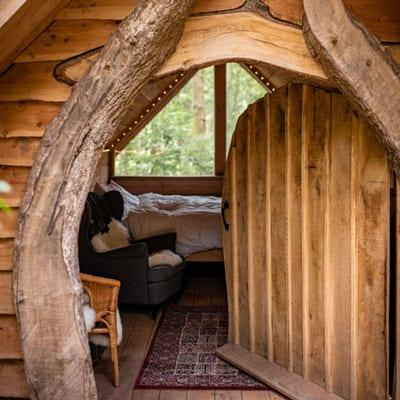 view of wooden hobbit doorway with bed inside