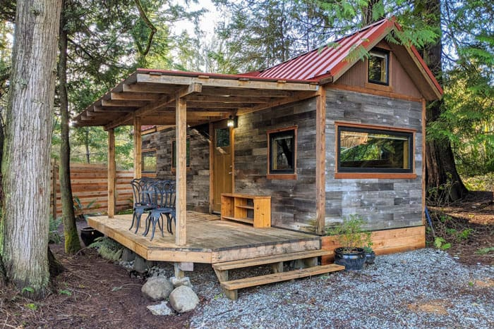 Tiny House in Salt Spring's Beautiful South End view of tiny home with deck in woods